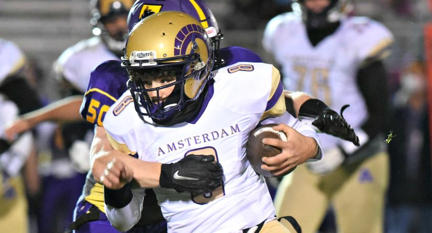 Amsterdam quarterback Jhai Vellon takes of up field during the second half Friday night at Ballston Spa in Class A football action last Friday.