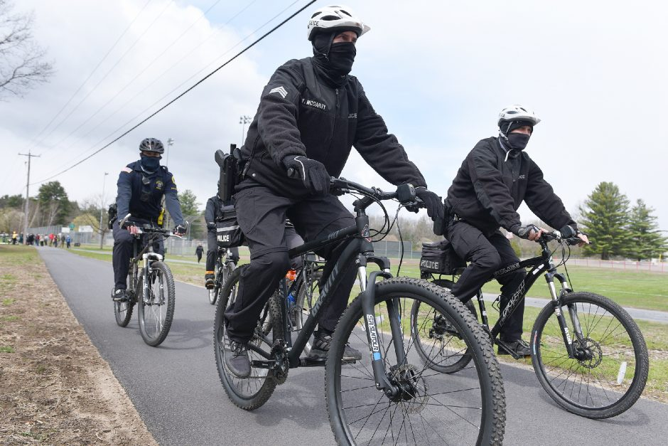 State Park Police, Saratoga Springs police officers and Bikeatoga members ride on the new Geyser Road bike path at Veteran's Park in Saratoga Springs on Thursday.