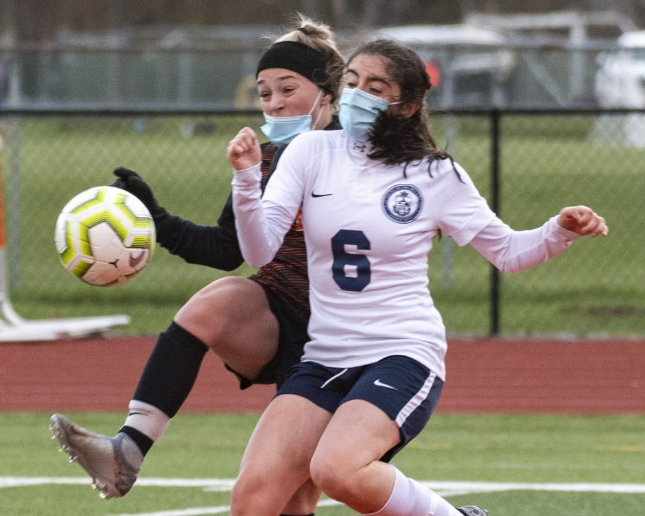 Mohonasen's Matti Swan and Mary Jordan of Holy Names go after the ball during Thursday's Colonial Council girls' soccer game.