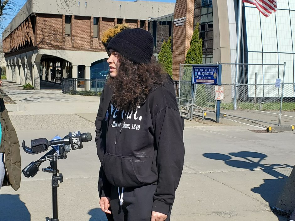 Activist Mikayla Foster stands in front of the Schenectady Police Station on Friday.