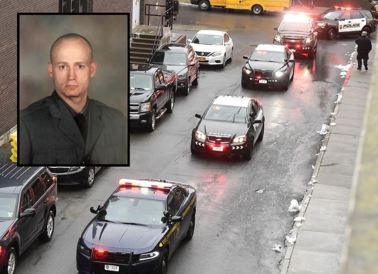 Sgt. Jeremy VanNostrand, inset, is pictured. Background photo shows police vehicles at VanNostrand's funeral.