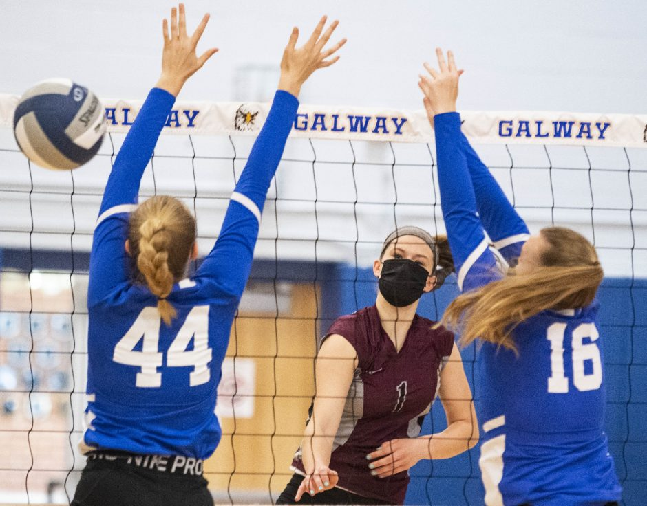 Burnt Hills-Ballston Lake's Carlie Rzeszotarski scores a point between Galway's Trishelle Oliver, left, and Grace O'Brien during Saturday's non-league girls' volleyball match.