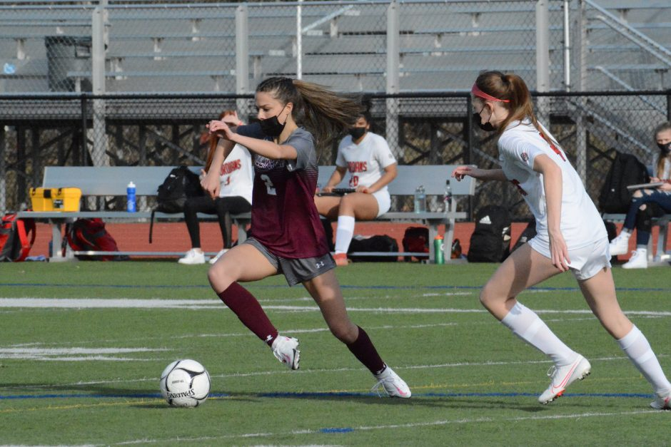 Stillwater's Katelyn Koval (2) dribbles past Waterford-Halfmoon defender Carly Cordts during a girls' soccer game March 23 at Stillwater High School.
