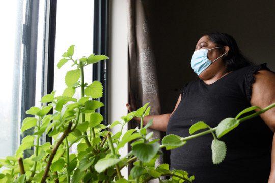 Suenietawattie Singh, of Schenectady, a Guyanese immigrant inside her client's home at Schaffer Heights in Schenectady last week