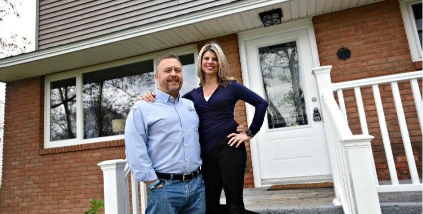 Glenn and Amber Schworm stand in front of their property on Sunrise Boulevard in Rotterdam. It is one of several properties that the couple owns in Schenectady County.