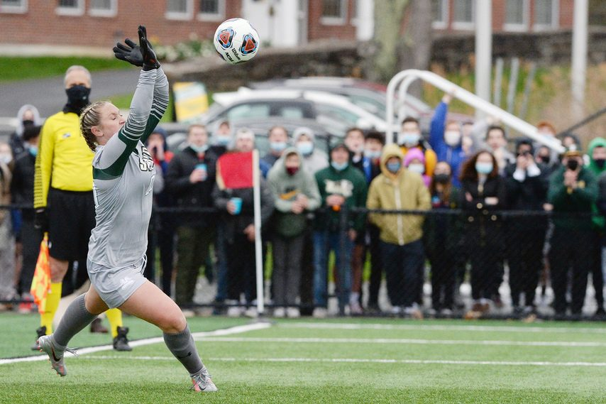 Siena goalie Leslie Adams blocks a shot by Monmouth in penalty kicks during the MAAC women's soccer championship game atHickey Field in Loudonville on Friday, April 16.