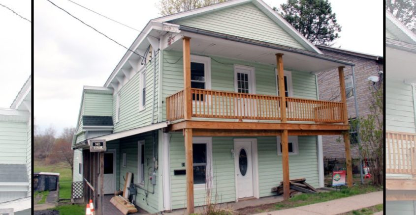The exterior of the home rehabilitated by the Greater Mohawk Valley Land Bank at 21 State St. in the village of Fort Plain is shown.