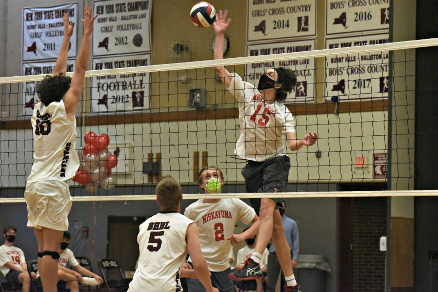 Niskayuna's Leith Chowdhrey looks to send the ball up and over a Burnt Hills-Ballston Lake defender Monday afternoon during the Suburban Council boys' volleyball tournament quarterfinals.