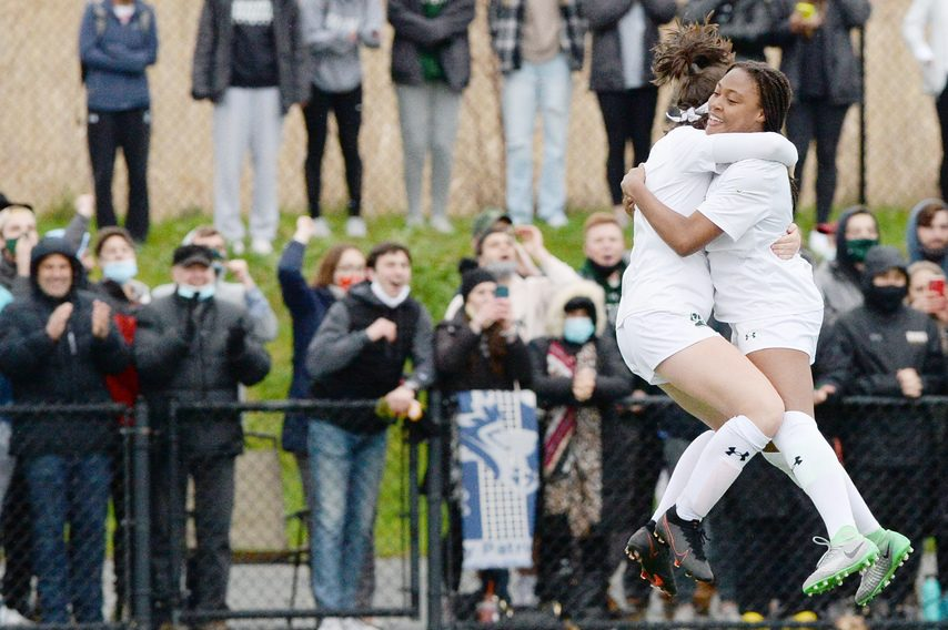 Siena's Emily McNelis and Brianna Montinard celebrate their win over Monmouthin the MAAC women's soccer championship game at Siena College in Loudonville on April 16.