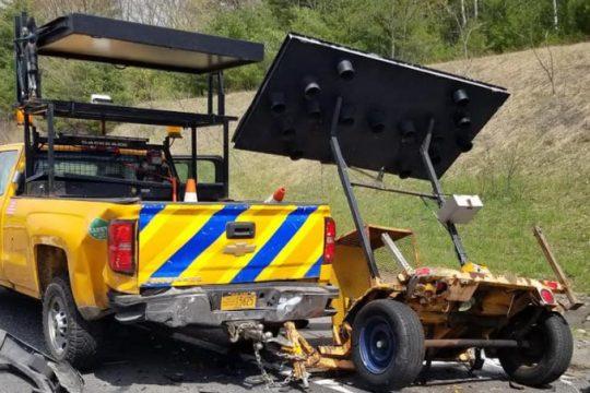 A damaged DOT vehicle at the scene.