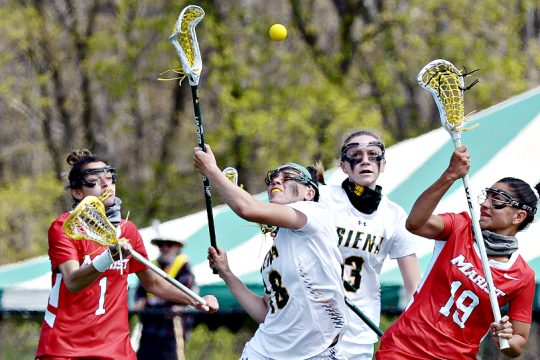 Nicole McNeely, second from left, is shown during a game last week against Marist. McNeely scored 7 goals in Siena's win Wednesday at Marist.