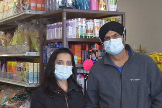 Gurbax Kaur (left) and Amrinder Singh (right), owners of Guru's Supermarket in Clifton Park.