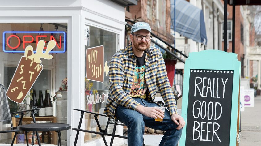 Pint Sized owner August Rosa, of Saratoga Springs, outside his craft beer establishment on Broadway in Saratoga Springs