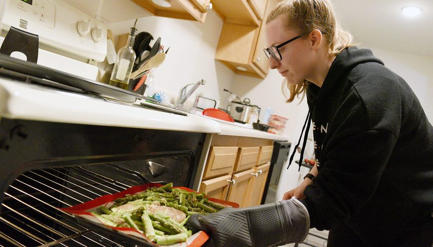 Daily Gazette reporter Shenandoah Briere prepares her oven roasted chicken and asparagus for a pea and mushroom gravy and rice dish, as she prepares her weeklong meals.