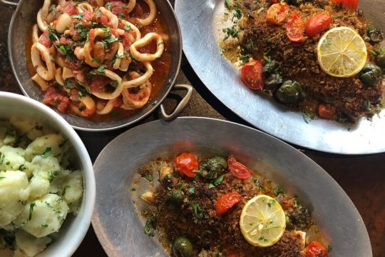 From Chianti Ristorante, Broiled Haddock with seasoned breadcrumbs served with cherry tomatoes and castelvetrano olives. Stewed cannellini beans with calamari and lightly spiced crushed tomato. Warm potato salad with olive oil and parsley.