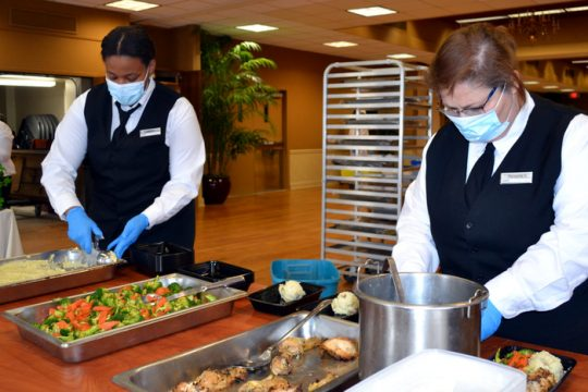 SUNY Schenectady Culinary Arts majors Evette Maisonette and Panagiota Giakoumis preparing meals for Feed Albany.