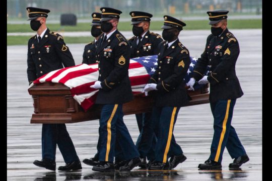 An Army Honor Guard carries the casket containing Spc. Abigail Jenks of the 82nd Airborne to a hearse at Albany International Airport Thursday