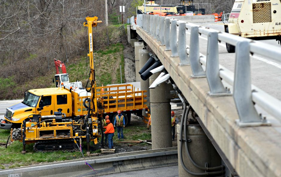 Construction crews work under the Sitterly Road bridge above the Northway last Sunday.