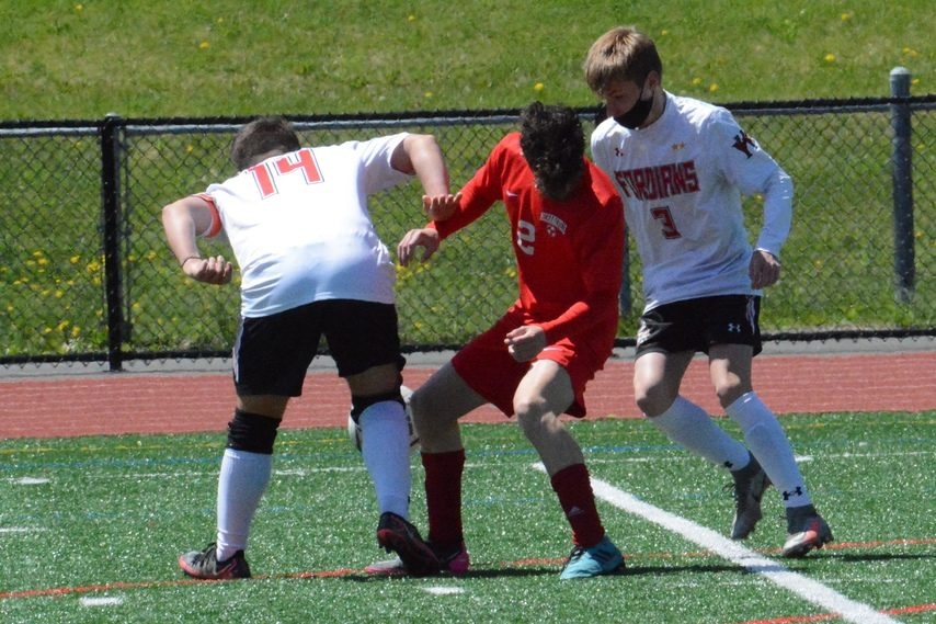 Mechanicville's TJ Bisaillon, center, fights for the ball between Waterford-Halfmoon's Ty Plumley (14) and Matt Soden during the Wasaren League boys' soccer championship game on Saturday, May 1 at Mechanicville High School.