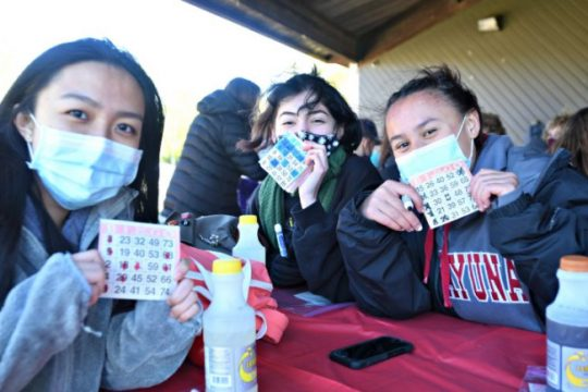 From left: Samantha Cerezo, 17, Madison Dominguez, 17, and Kaylin Schneider, 16, are all smiles as they hold up their bingo cards the afternoon of Saturday.