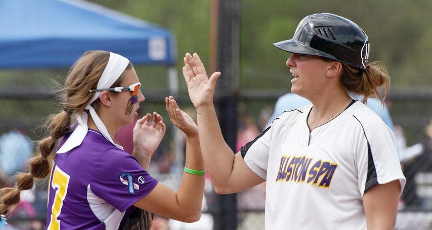 Ballston Spa head coach Amanda Fifield high-fives Caroline Srokowski during their Class A state championship softball game against Williamsville East at Moreau Rec Fields in Moreau on Saturday, June 15, 2019.