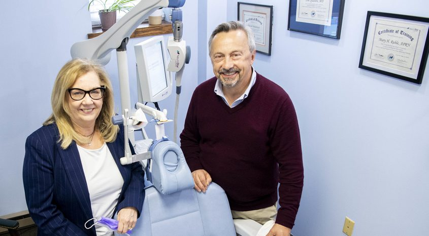 Nurse Practitioner Mary Ruhle, left, and Dr. Thomas Qualtere with the NeuroStar TMS, used for treatment of depression, at Schenectady Mental Health on Union Street in Schenectady.