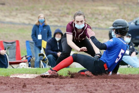 Broadalbin-Perth's Alexis Johnson slides into third base as Fonda-Fultonville's Amber Cole applies the tag during Tuesday's non-league softball game in Broadalbin.