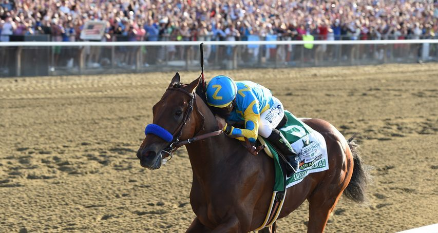 CHELSEA DURAND/NYRA PHOTOAmerican Pharoah and jockey Victor Espinoza win the 2015 Belmont Stakes to complete the Triple Crown.