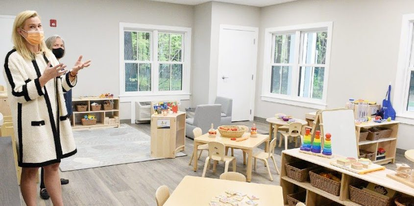 Association Board President Libby Imperio tours the toddler room on Wednesday.
