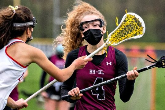 Burnt Hills-Ballston Lake's Allie Connally is defended by Guilderland's Elizabeth Shafer during Wednesday's Suburban Council girls' lacrosse game.