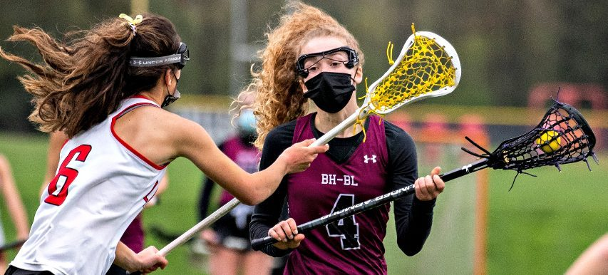 Burnt Hills-Ballston Lake's Allie Connally is defended by Guilderland's Elizabeth Shaferduring Wednesday's Suburban Council girls' lacrosse game.