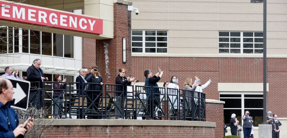 Saratoga Hospital staff members receive cheers by local residents outside the hospital on Myrtle Street in Saratoga Springs on April 3, 2020.