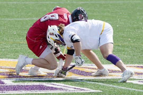 ERICA MILLER/THE DAILY GAZETTE Faceoff specialist Regan Endres, right, and the UAlbany men's lacrosse team have a tough assignment against Vermont in Saturday's America East championship game.