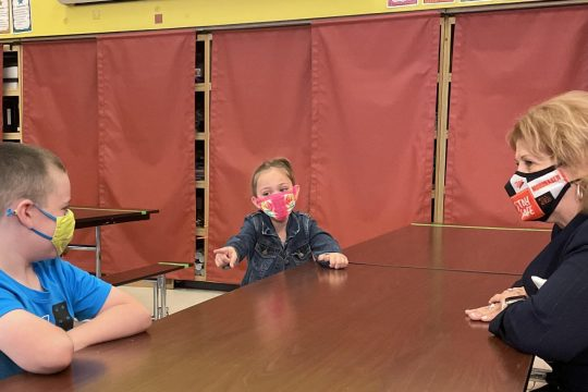 Mohonasen second-graders Everett Sowards, left, and Theresa Nelson, center, sit in the Bradt Primary School cafeteria with administrative aide Ann Valdes