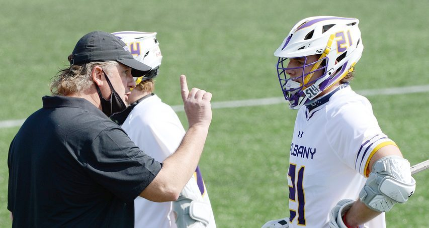 UAlbany men's lacrosse coach Scott Marr, left, talks to freshman Camden Hay during a game earlier this season at Tom & Mary Casey Stadium in Albany. Saturday, UAlbany lost 15-10 to Vermont in the America East championship game.