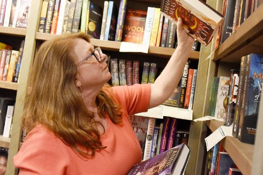 General Manager Nancy Scheemake, of Shushan, places order for a customer for curbside pickup order at Northshire Bookstore on Broadway in Saratoga Springs on Tuesday, March 17, 2020. Customers can order curbside pickup or free shipping orders due to quarantined and social distancing.