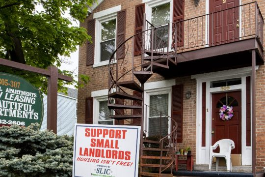A sign remindingpassersbyto support small landlords is seen on the front lawn of 305-307 Front St. in Schenectady on Saturday, May 8, 2021.
