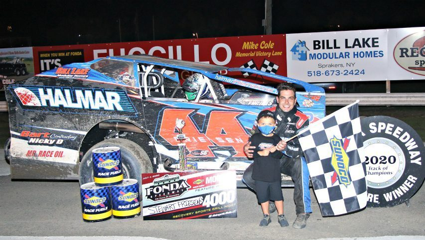 Stewart Friesen in victory lane at Fonda Speedway with his son, Parker, after a win in 2020. (Photo courtesy Jeff Karabin)