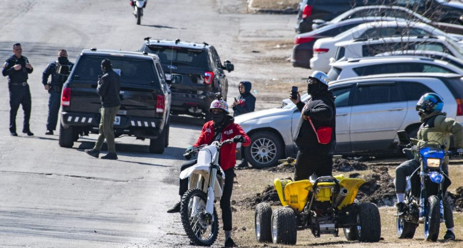 Schenectady police officers Sgt. Christopher Scaccia and Jeffrey St. Onge, left, are taunted by dirt bike and 4-wheeler riders on Fehr Avenue near State Streeton March9.