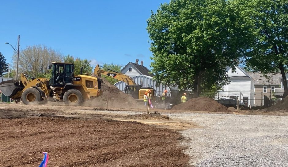 A front end loader and excavator at work in May at Orchard Park on Crane Street in Schenectady.