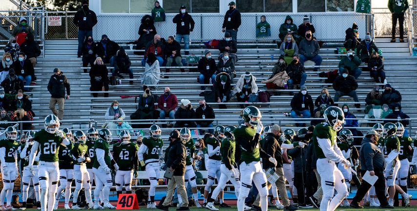 Fans partially fill the bleachers for the first football game of the season at Shenendehowa High School on March 19.
