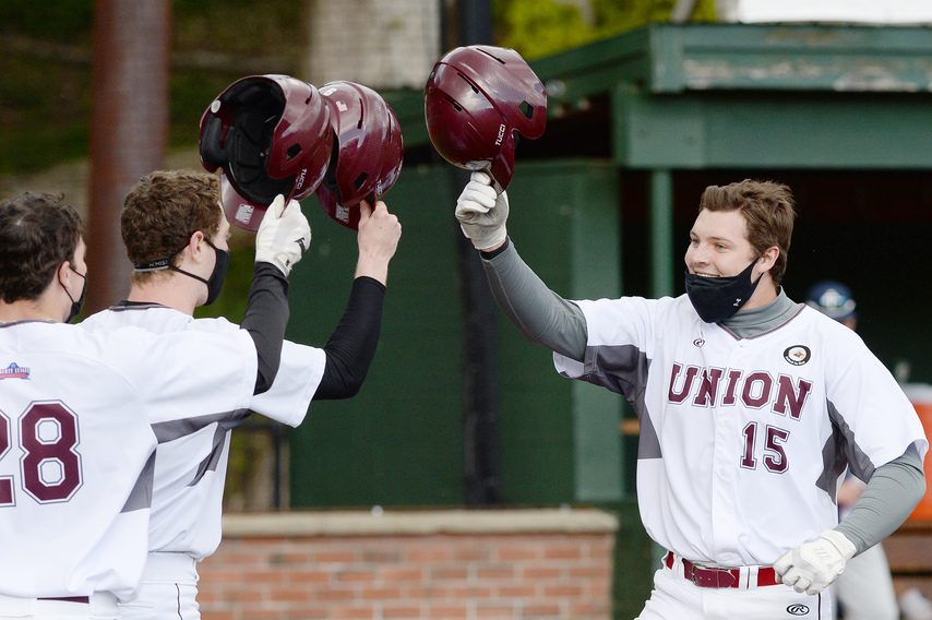 Chris O'Brien of Union College celebrates with teammates after hitting a home against Ithaca College in Wednesday's Liberty League semifinal game at Shuttleworth Park in Amsterdam.