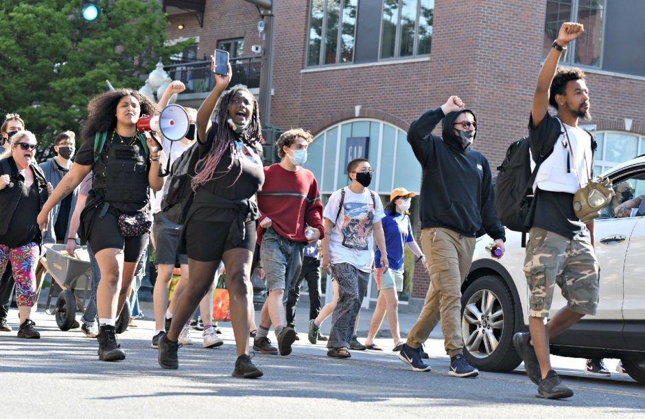 Lexis Figuereo leads Black Lives Matter protestors up Broadway in Saratoga Springs as they made their way to City Hall from Congress Park Sunday afternoon.