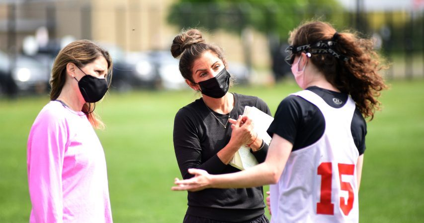 Niskayuna girls' varsity coach Alexis Licht (left) and assistant coach Kelly Lephart (center) talk to a player during a recent practice