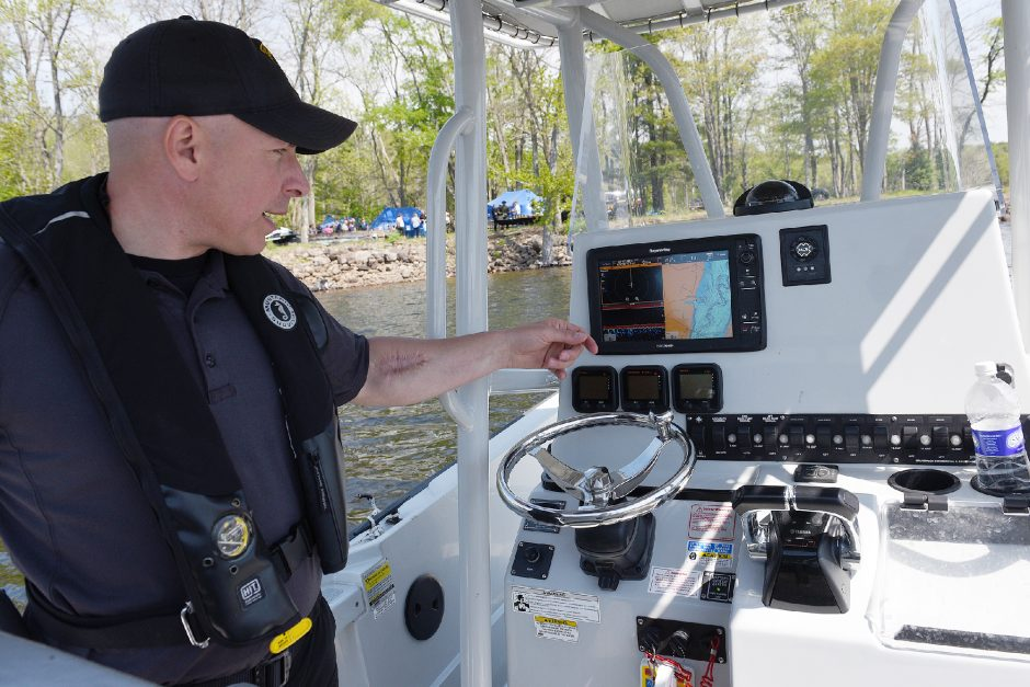 Saratoga County Sheriff's Deputy Biagio Guida points at GPS maps on the Sheriff's Department's boat on Great Sacandaga Lake after a press conference for the Sober Boater Campaign at Edinburg Marina in Edinburg on Thursday.
