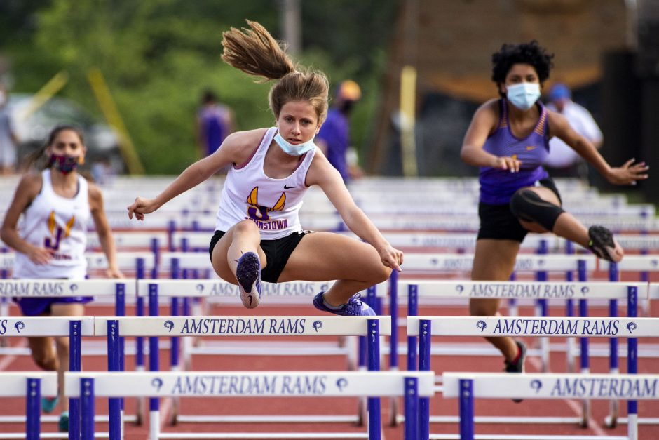 Johnstown's Mary Austin races to a second place finish in the 100 meter hurdles at Amsterdam High School on Thursday.
