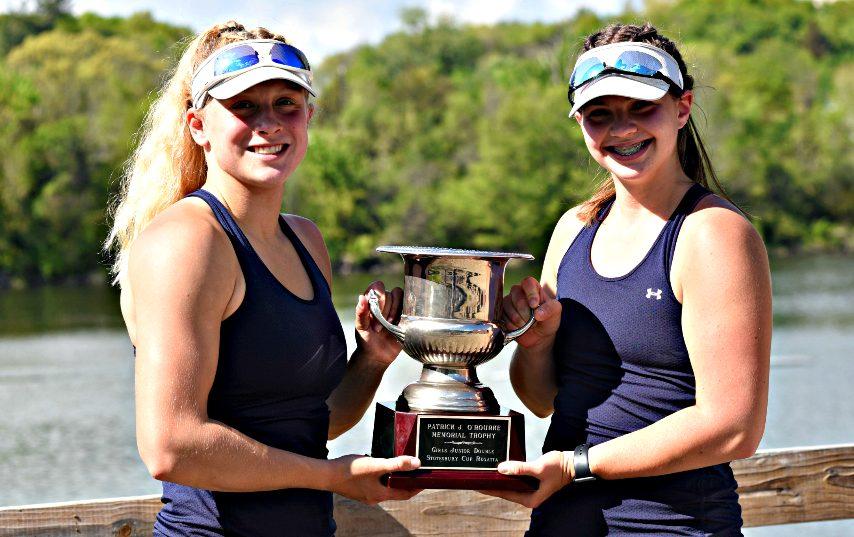 Niskayuna High School juniors Heather Schmidt, left, and Jordan Zenner hold up their first-place trophy after winning the junior girls' double at the Stotesbury Cup Regatta in Philadelphia last weekend.