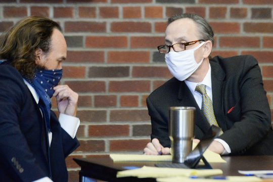 Georgios Kakavelos, right, talks to his attorney, Kevin K. O'Brien, before the jury arrives for opening statementsinhismurder trial on May 12.