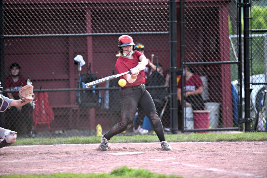 STAN HUDY/THE DAILY GAZETTEAyanna Ortiz-Nicklas gets around on a pitch against Queensbury Friday afternoon in Foothills Council action at Scotia-Glenville Middle School softball fields. May 21, 2021.