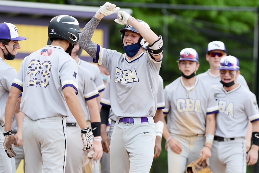 Ryan Bilka of CBA celebrates with teammates after hitting a grand slam in Friday's baseball game against Ballston Spa at Ballston Spa High School.